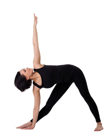 young woman training in yoga - triangle pose isolated