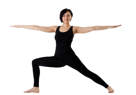young woman training in yoga - Hight Lunge isolated stand pose Stock Photo - 9479796