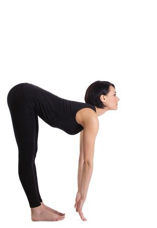 young woman training in yoga asana - flat back palms on the floor photo