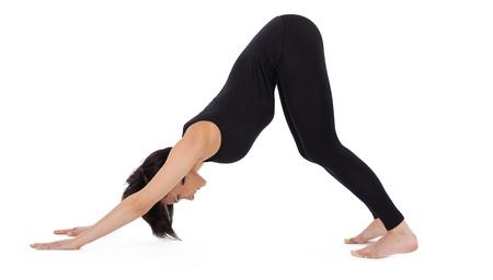 knees bent: young woman training in yoga pose - Adho Mukha Svanasana asana with bent knees Stock Photo