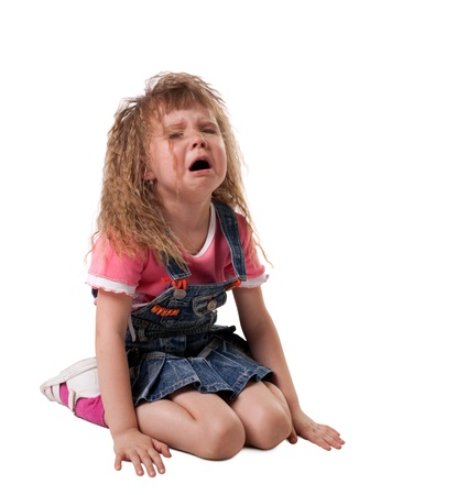 crying kid sit on white, jeans cloth - isolated photo