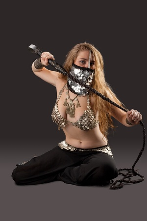 Young Woman dance with knout in chain mail on breast- traditional arabia costume Stock Photo - 9479864