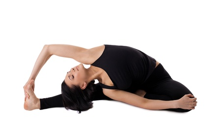 revolved: young woman training in yoga asana- Revolved Head-to-Knee pose isolated Stock Photo