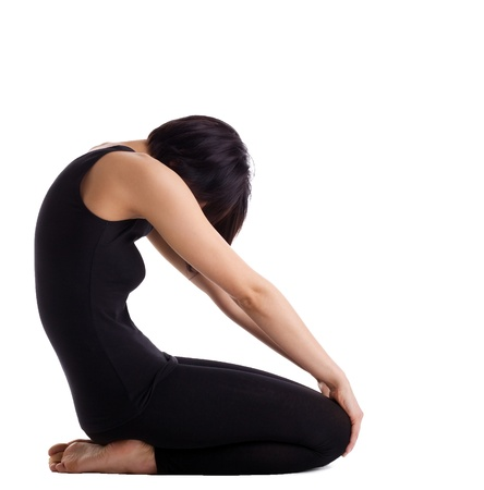 Young woman prepare for yoga asana - no face isolated photo