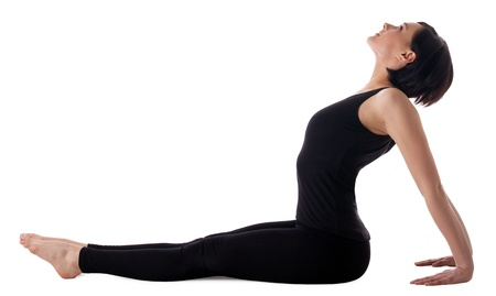 Young relaxed woman sit in yoga simple seated pose isolated photo