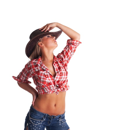 pretty young cowgirl take hand on hat in desire isolated