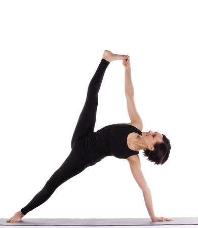 young woman training in yoga - Vasisthasana Side Plank pose isolated Stock Photo - 9536782