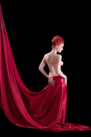 Beautyful young naked red woman in dark Standard-Bild