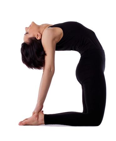 pilates studio: young woman training in yoga asana - Ustrasana camel Pose isolated