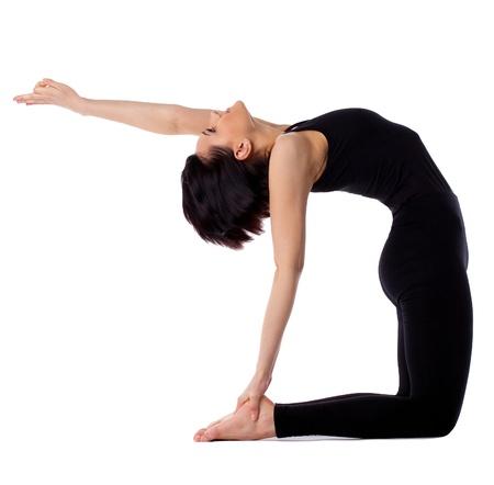 young woman training in yoga asana - Ustrasana camel Pose isolated photo