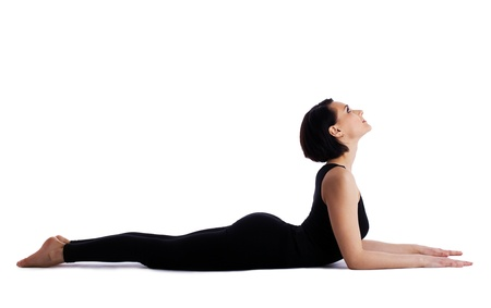 young woman training in yoga asana - sphinx pose isolated photo