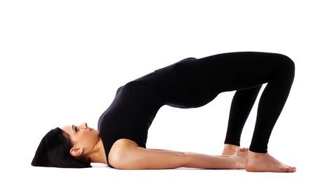 young woman training in yoga bridge - Setu Bandha Sarvangasana Pose isolated photo