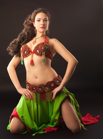 Young woman posing  in traditional arabic costume photo