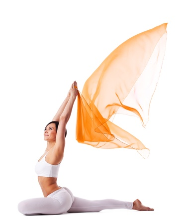 Young woman in yoga asana and flying cloth - pigeon pose isolated Stock Photo - 9618960
