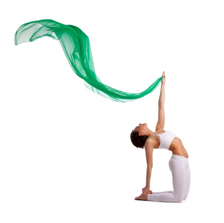 woman in yoga camel pose with green fluing veil in air isolated Stock Photo - 9653093