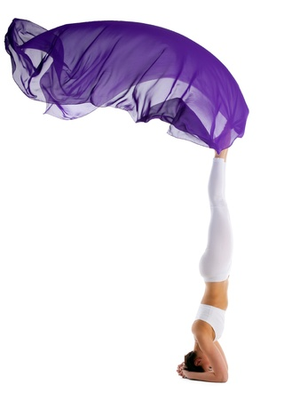 Young beauty woman stand on head in yoga chakra with purple fabric isolated Stock Photo - 9653117