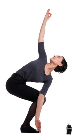 Young businesswoman stand in yoga asana with clock - pray for time isolated photo