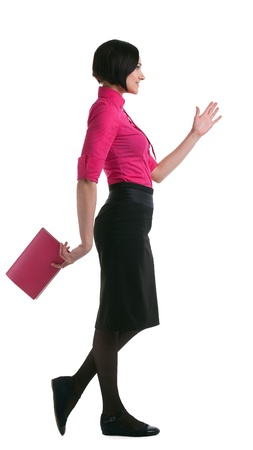 young businesswoman in pink suit walk forward with book isolated photo