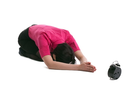 young woman in business suit lay in yoga asana - pray for time isolated photo