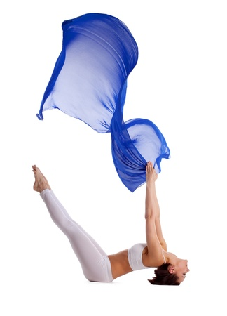 Young beauty woman lay in yoga pose and blue flying veil isolated Stock Photo - 9653116