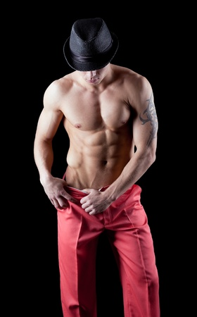 sexy young man show striptease in red suit