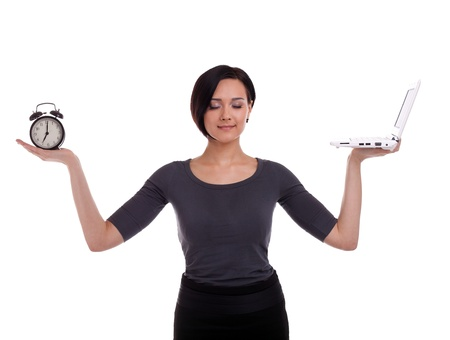 job deadline: Young business woman time management with clock and laptop isolated