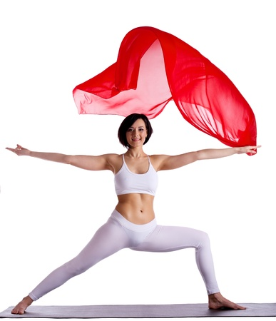 Young beauty woman exercise yoga pose and red flying cloth on mat Stock Photo - 9700185
