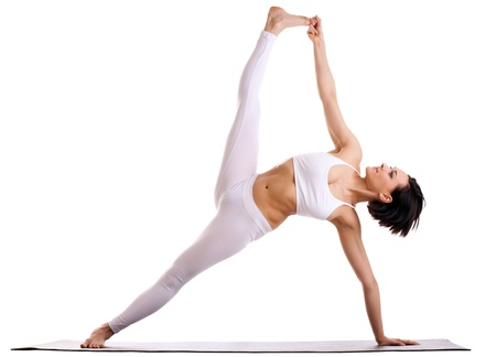 side pose: young woman training in yoga - Vasisthasana Side Plank pose isolated