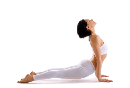young woman pose in yoga pose - upward facing dog isolated
