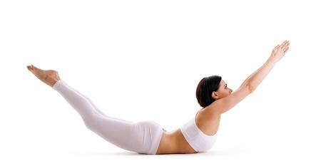 pilates studio: young woman training in yoga asana isolated