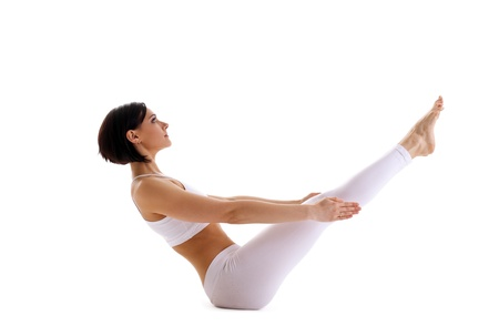 pilates studio: young beauty woman in white lay in yoga asana - fish pose isolated