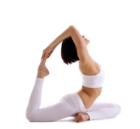 yoga: young woman training in yoga asana - pigeon pose isolated