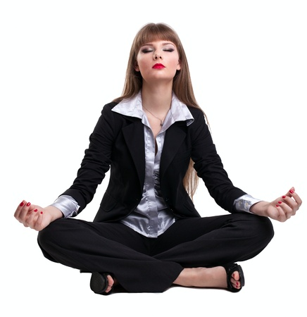 Yong business woman sit and relax in yoga pose lotos