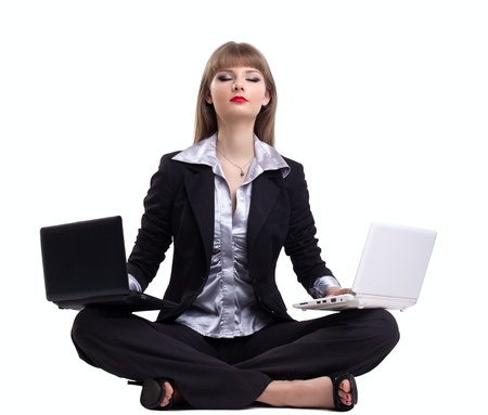 Yong business woman exercise yoga relax with two laptop isolated Stock Photo - 9700260
