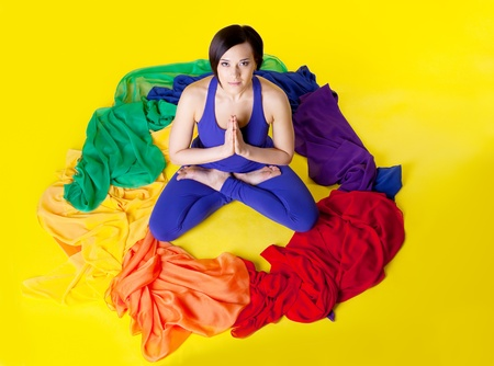Beauty young woman sit in color ring - rainbow of yoga photo