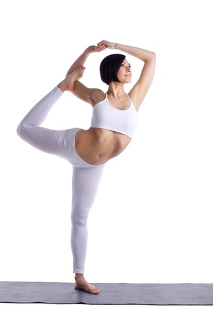 yoga  pose: young beauty woman doing yoga asana in white on rubber mat isolated Stock Photo