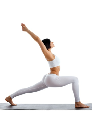 young woman training in yoga pose - warrior asana isolated