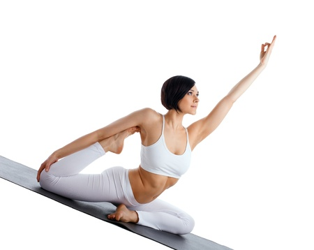 beauty young woman doing yoga on rubber mat Stock Photo