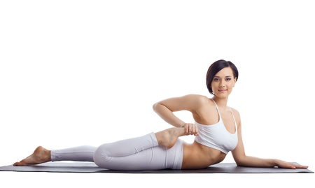 Young beauty woman in yoga bend  on rubber mat isolated Stock Photo - 10104206