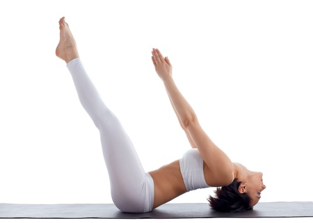 woman exercise bend yoga pose on rubber mat isolated Stock Photo