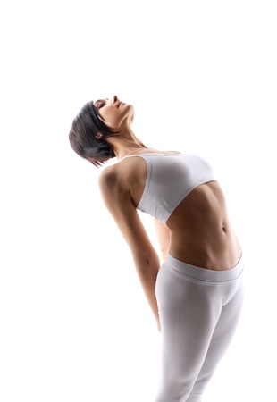 Young beauty woman in white doing yoga exercise with abdomen