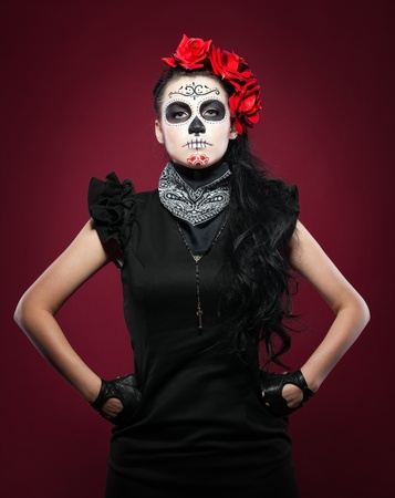 Young woman wearing with roses dressed up for All Souls Day photo