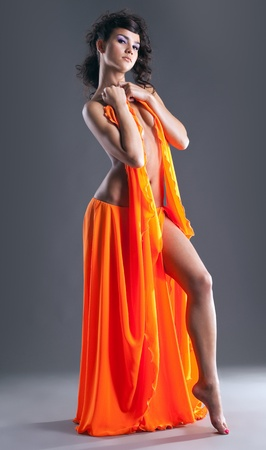 beauty young girl dance with orange veil