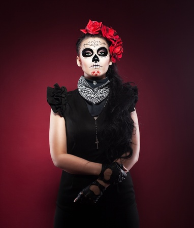 women face stare: Young woman wearing with roses dressed up for All Souls Day Stock Photo