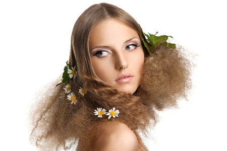 Beauty young girl spring portrait  with leaves and camomile in hair Stock Photo - 10493915