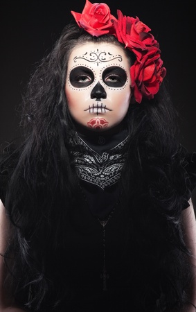 Serious woman in day of the skull mask Stock Photo