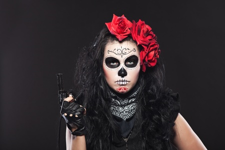 dia de los muertos: Young woman wearing with roses dressed up for All Souls Day Stock Photo