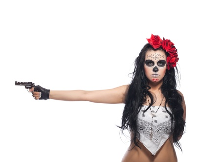 dia de los muertos: woman wearing with roses dressed up for All Souls Day with gun isolated Stock Photo