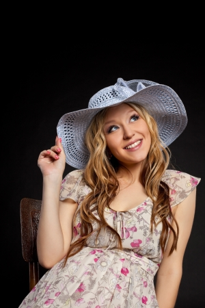 Young beauty blond pregnant woman portrait in straw hat Stock Photo - 10592886