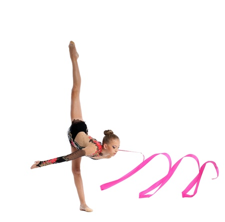 little girl smiling: Beautiful teenager girl doing gymnastics split with ribbon